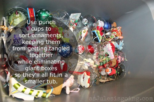 Use punch cups to sort ornaments, keeping them from getting tangled together while eliminating giant boxes so they'll all fit in a smaller tub.
