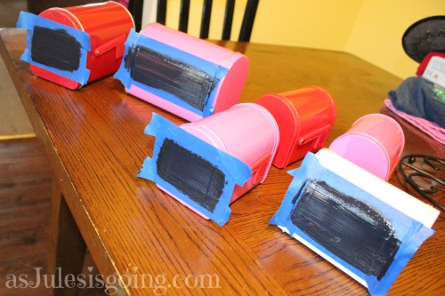 paint mini chalkboards on front and side of mailboxes to personalize them